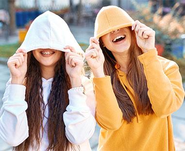 Teenage Girls wearing hoodies